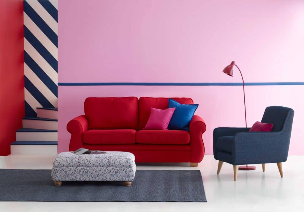 Harvey's red sofa and bluer chair in a pink and red stripped setting modern style loft contemporary