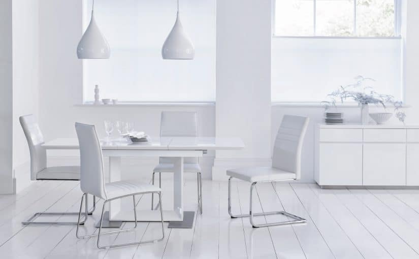 Harvey's furniture white dining table and chairs on a white floor modern style contemporary loft style