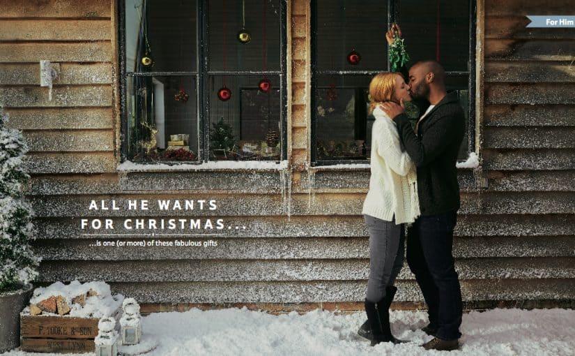 Couple under the mistletoe for the Tesco Christmas Gift guide